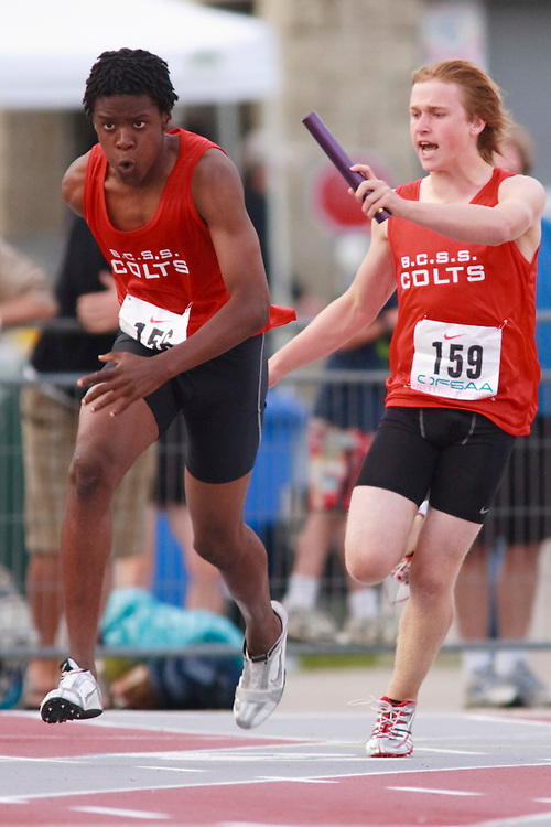 (London, Ontario}---09 June 2010) Lamar Grogan of Bill Crothers S S (Unionville) receives the baton from teammate Michael Morgan during the 4 X 100 meter relay heats at the 2010 OFSAA Ontario High School Track and Field Championships. Photograph copyright GEOFF ROBINS / Mundo Sport Images, 2010.
