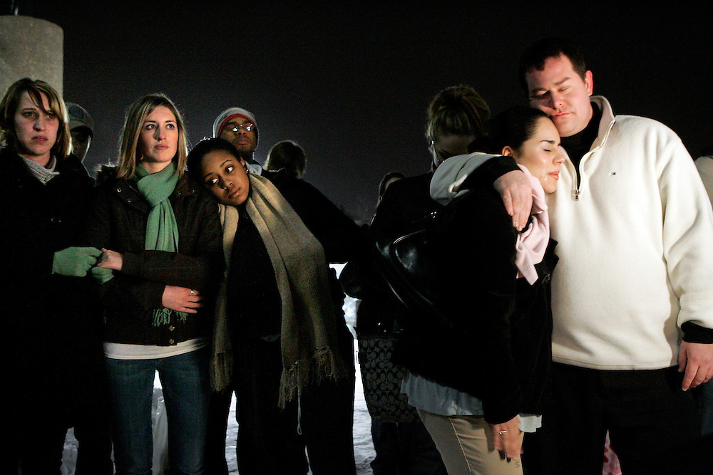Northern Illinois University students take part in a prayer vigil after a mass shooting on the school campus earlier that day, Thursday, Feb. 14, 2008 at Central Park in Dekalb.<br /> SCOTT MORGAN | ROCKFORD REGISTER STAR