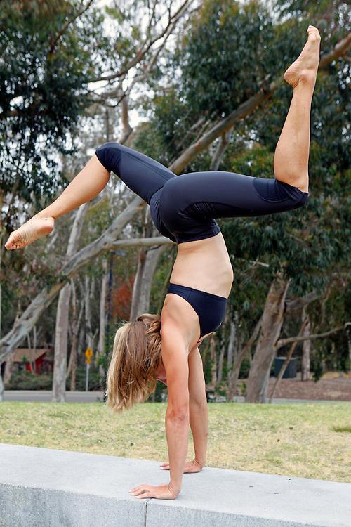 "Healthy physically fit woman in 30's, or female acrobat of ""Cirque de la Mer"" portfolio shoot."