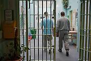 Enhanced prisoners walking down the corridor on H wing at YOI Aylesbury.
