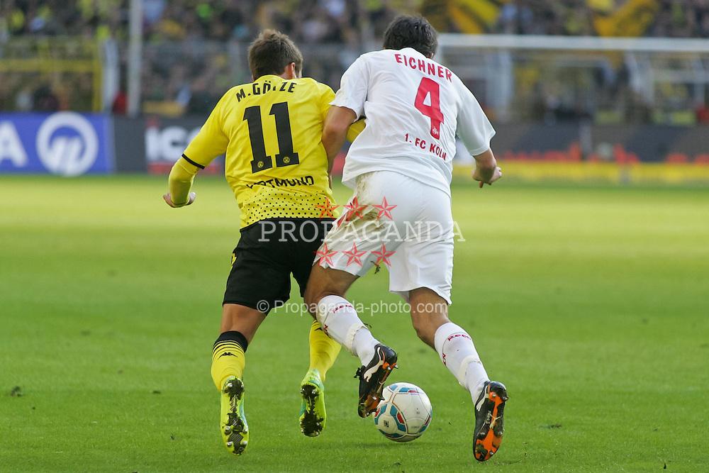 22.10.2011, SIGNAL IDUNA Park Dortmund, Dortmund, GER, 1.FBL, Borussia Dortmund vs 1. FC Köln / Koeln, im Bild Mario Götze (Dortmund #11) gegen Christian Eichner (Koeln #4)...// during the 1.FBL,  Borussia Dortmund vs 1. FC Köln / Koeln on 2011/10/22,  SIGNAL IDUNA Park Dortmund, Dortmund, Germany. EXPA Pictures © 2011, PhotoCredit: EXPA/ nph/  Herbst       ****** out of GER / CRO  / BEL ******