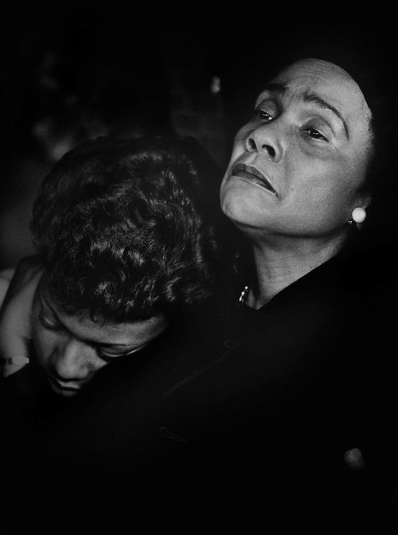 "Coretta Scott King, widow of the slain civil rights leader Dr. Martin Luther King, Jr., comforts her daughter as they attend the funeral of Dr. Martin Luther ""Daddy"" King, Sr. at King's Ebenezer Baptist Church in Atlanta, Georgia."