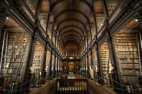 "Trinity College Library Dublin is the library of Trinity College and the University of Dublin. It is the largest library in Ireland and, as a legal deposit or ""copyright library"", it has rights to receive material published in the Republic of Ireland free of charge; it is also the only Irish library to hold such rights for the United Kingdom. The Library is the permanent home to the famous Book of Kells. Two of the four volumes are on public display, one opened to a major decorated page and the other to a typical page of text. The volumes and pages shown are regularly changed."