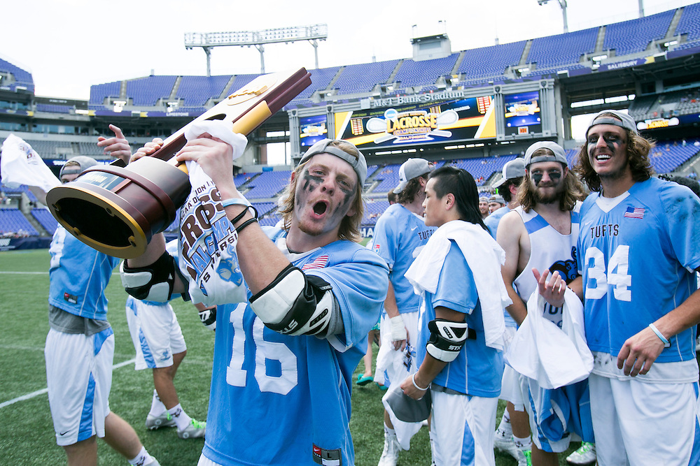 05/25/2014 - Baltimore, Md. - Tufts defenseman Kane Delaney, A14, celebrates with the NCAA Division III Men's Lacrosse National Championship trophy after beating Salisbury, 12-9, at M&T Bank Stadium on May 25, 2014. (Kelvin Ma/Tufts University)