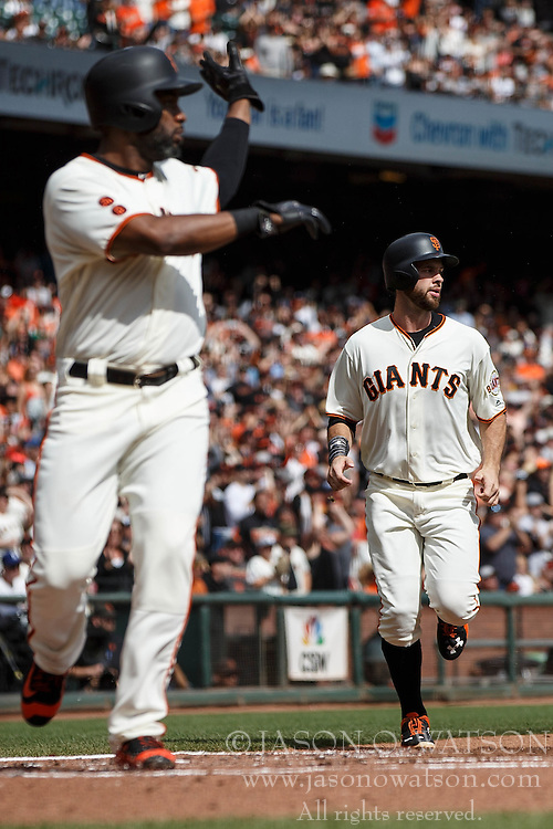 SAN FRANCISCO, CA - OCTOBER 02: Denard Span #2 of the San Francisco Giants and Brandon Belt #9 score runs on a single hit by Buster Posey (not pictured) during the first inning against the Los Angeles Dodgers at AT&T Park on October 2, 2016 in San Francisco, California.  (Photo by Jason O. Watson/Getty Images) *** Local Caption *** Denard Span; Brandon Belt