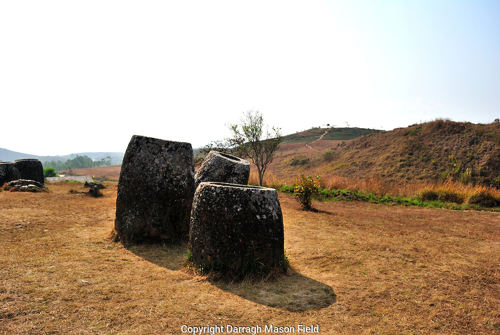 The Plain of Jars, a megalithic archaeological landscape in Laos.  Plain of Jars is dated to the Iron Age (500 BCE to 500 CE) and is one of the most fascinating and important sites for studying Southeast Asian prehistory.