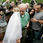 Bob Schindler (C) looks at a statue of the Virgin Mary presented to him by supporters of his daughter Terri Schiavo outside  the Woodside Hospice on March 23, 2005 in Pinellas Park, Fla. Behind right is his daughter Suzanne Vitadamo. Photo by Scott Audette/Reuters