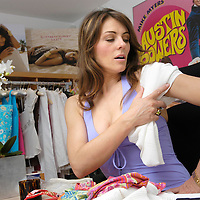 Elizabeth Hurley with her swimwear designs in her studio in South Kensington, London, UK. Sold exclusively in Harrods and Saks in New York. .