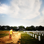 """Colin and Dana Kelly, (both of Austin, TX) visit Section 60 at Arlington National Cemetery in Arlington, VA on Saturday, July 25, 2009.  Mr. Kelly served as an Infantry officer in the 1st Battalion, 506th Regiment, """"B"""" Company in Iraq in 2004 and 2005 and visits a fallen comrade once a year."""