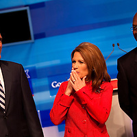 ORLANDO, FL -- September 22, 2011 -- Republican presidential candidates Gov. Mitt Romney, left to right, Congresswomen Michele Bachmann, and Herman Cain chat during the Florida P5 at the Orange County Convention Center in Orlando, Fla., on Thursday, September 22, 2011.  Nine Republican presidential candidates congregated for a Fox News / Google Debate.   (Chip Litherland for The New York Times)