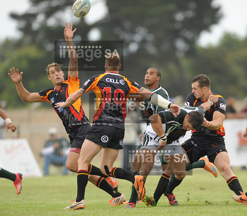 GEORGE, SOUTH AFRICA - Saturday 7 March 2015, Kyle Dutton of Vaseline Wanderers grapples for the ball during the third round match of the Cell C Community Cup between Pacaltsdorp Evergreens and Vaseline Wanderers at Pacaltsdorp Sports Grounds, George<br /> Photo by Roger Sedres/ImageSA/ SARU