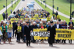 © London News Pictures. 29/03/2017. Belfast, Northern Ireland. Campaign group Border Communities Against Brexit arrive to hold a protest at Stormont. Prime Minister Theresa May has triggered Article 50 of the Lisbon Treaty starting a two year countdown to the UK's exit. Photo credit: Paul McErlane/LNP