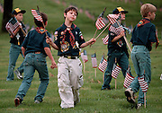 Young scouts converge on the Willamette National Cemetery to plant American flags about each grave site to commemorate Veteran's Day.
