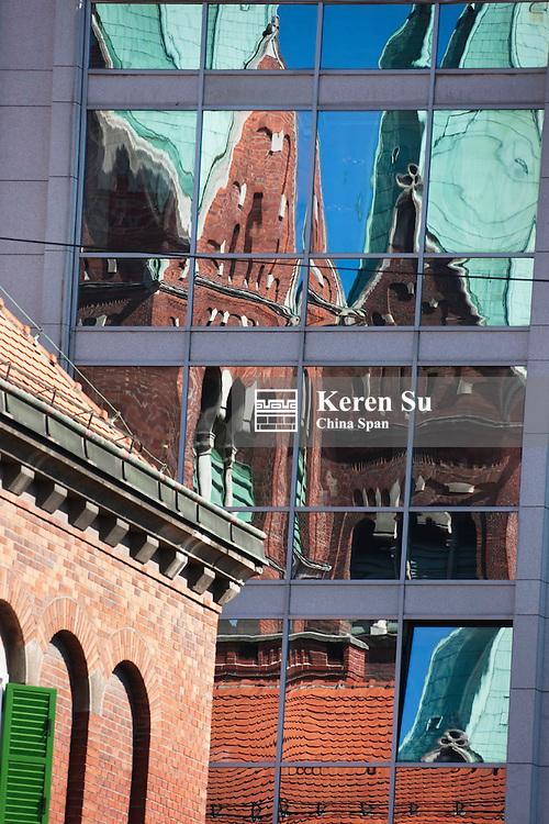 Reflection of Franciscan Church on building glass window, Maribor, Slovenia