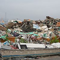 Damaged fishing boats and debris lay mixed together, remnants of the destruction caused by the 2011 tsunami, in the Matsukawaura district of Soma, Japan, on Monday 23 July 2012.
