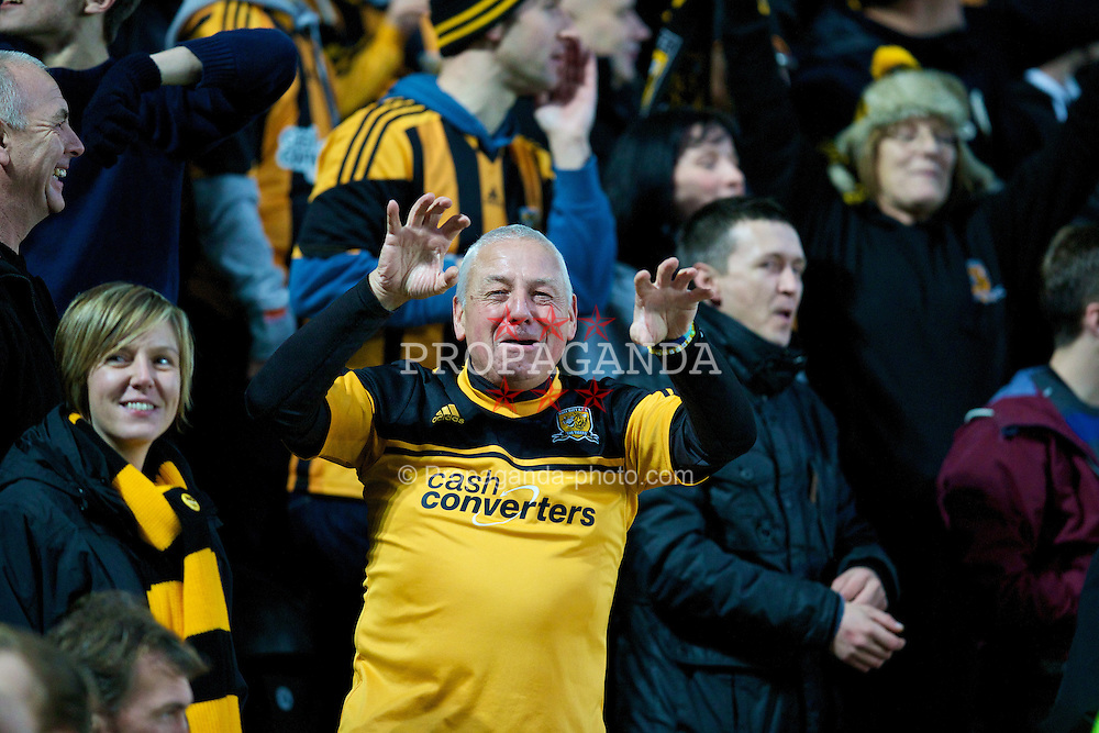 HULL, ENGLAND - Sunday, December 1, 2013: A Hull City supporter sings 'You're getting mauled by the tigers' during the Premiership match against Liverpool at the KC Stadium. (Pic by David Rawcliffe/Propaganda)