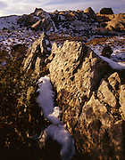 AA00846-04...COLORADO - Sandstone ribs sticking out of the snow at Dinosaur National Monument.