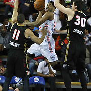 Delaware 87ers Forward Ronald Roberts (12) attempts to past the ball as Erie BayHawks Guard Drew Crawford (11) and Erie BayHawks Forward Daniel Coursey (30) defends in the first half of a NBA D-league regular season basketball game between the Delaware 87ers and the Erie BayHawk (Orlando magic) Friday, Jan. 02, 2015 at The Bob Carpenter Sports Convocation Center in Newark, DEL
