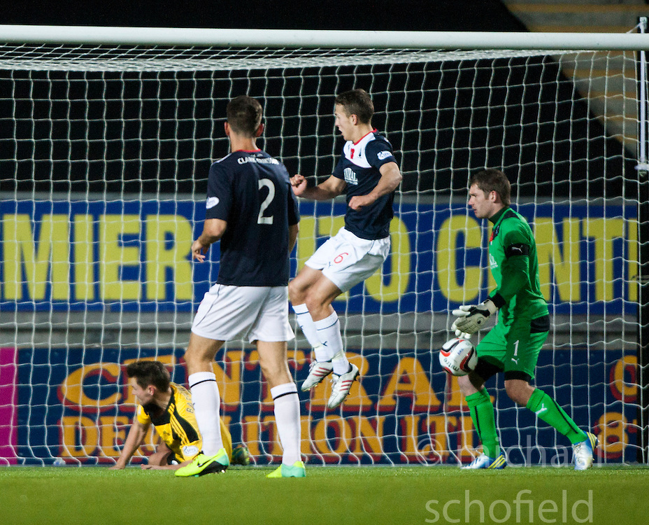 Falkirk's keeper Michael McGovern saves after Will Vaulks clears the ball off  Livingston Andy Barrowman.<br />