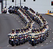 Metro Motorcycle Officers are joined by those from other area departments as they lead the body of slain Metro Officer Igor Soldo to the Palm Mortuary for funeral services in Las Vegas, Nevada.