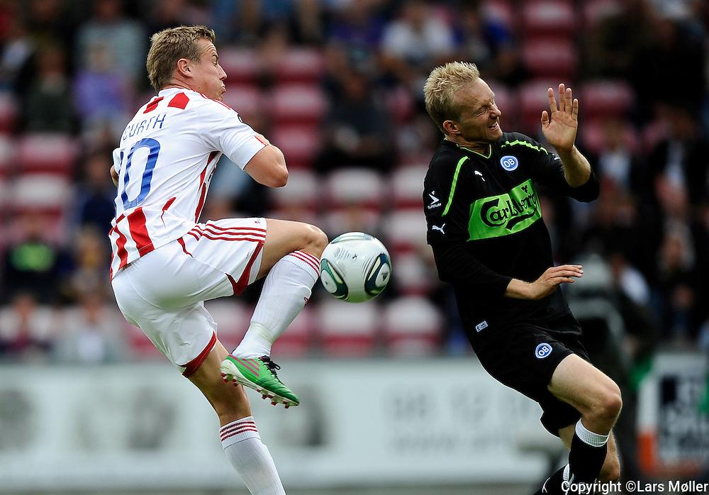 DK Caption:<br /> 20110813, &Aring;lborg, Danmark:<br /> Superliga fodbold, AAB - OB:<br /> Jeppe Curth, Aab Aalborg., Anders M&oslash;ller Christensen, OB Odense.<br /> Foto: Lars M&oslash;ller<br /> <br /> UK Caption:<br /> 20110813, Aalborg, Denmark:<br /> Superleague football  AAB - OB:<br /> Jeppe Curth, Aab Aalborg., Anders M&oslash;ller Christensen, OB Odense.<br /> Photo: Lars Moeller