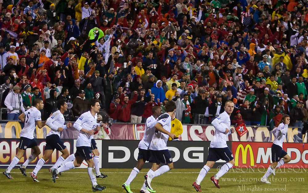 The US Men's National Team celebrates the game's first goal against Mexico.  The United States men's soccer team defeated the Mexican national team 2-0 in CONCACAF final group qualifying for the 2010 World Cup at Columbus Crew Stadium in Columbus, Ohio on February 11, 2009.