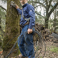 Vacaville resident and forty-three year employee of AT&T Dave Richardson repairs a downed line on Petrified Forest Road in Calistoga