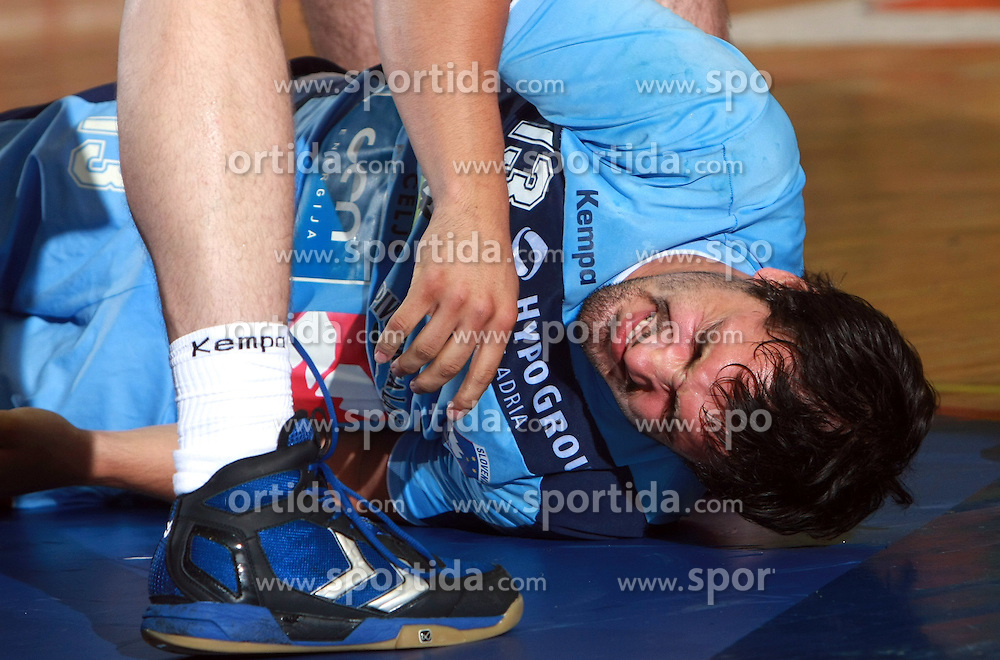 David Spiler of Slovenia injured at  handball game between men national teams of Slovenia and Slovakia, first qualification game for the World Chamionship 2009, on June 7, 2008, in Arena Zlatorog, Celje, Slovenija. Result: 33 : 33. (Photo by Vid Ponikvar / Sportal Images)