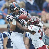 Mississippi wide receiver Donte Moncrief (12) makes a catch against Troy cornerback Ethan Davis (34) at Vaught-Hemingway Stadium in Oxford, Miss. on Saturday, November 16, 2013. (AP Photo/Oxford Eagle, Bruce Newman)