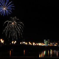 Fireworks display from the lights on the river festival in Owego, NY. Display over the Susquehanna river with the bridge leading into Owego.