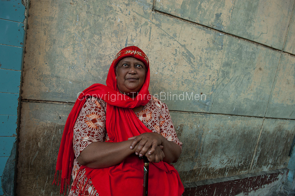 Mauritius. Woman in red. Port Louis.