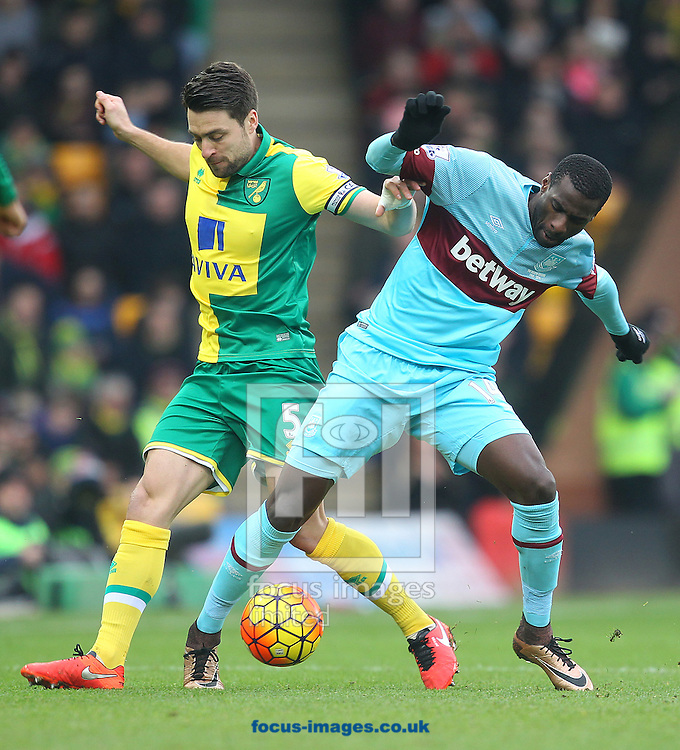 Russell Martin of Norwich and Pedro Obiang of West Ham in action during the Barclays Premier League match at Carrow Road, Norwich<br /> Picture by Paul Chesterton/Focus Images Ltd +44 7904 640267<br /> 13/02/2016