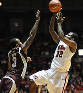 "Mississippi's Jarvis Summers(32) shoots over Mississippi State's Dee Bost (3) at the C.M. ""Tad"" Smith Coliseum in Oxford, Miss. on Wednesday, January 18, 2012. Mississippi won 75-68. (AP Photo/Oxford Eagle, Bruce Newman)."