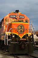 A Burlington Northern Santa Fe locomotive rests in the late afternoon sunshine.