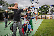 2016/04/28 &ndash; Medellín, Colombia: German Gomez, 49, practices arrowing with a few colleagues at the Belen Sports Complex, Medellin, 28th April, 2016.<br /> -<br /> German used to look for gold with his father on the region of Choco. But the National Liberation Army (ELN) started to threaten them and wanted Germans family to pay to the ELN for &ldquo;protection&rdquo;. Because German&rsquo;s family refused to pay, they had to leave their village and everything behind. They became displaced. Despite this, the guerrilla did not stop chasing them and when they found them, German and his father were both shot. His father died. German suffered an injury in his last vertebra, becoming paraplegic. <br /> With the help of a Foundation that supports victims through sports, German started his rehabilitation program. First, he started with swimming, he had never swum before but only after 6 months he won a silver medal at a competition. But months later he had a cramp while practising, and almost drown. The incident made him so afraid that he&rsquo;s never returned to a swimming pool again. <br /> As German was good at shooting in the army, he decided to try a sport that requires this skill. He started to focus on arrowing and after a few months he qualified for the 2015 Pan-American Games where he finished in 5th place. German managed to qualify to the Rio 2016 Paralympic, and his goal is not only to get a good result, but he also needs it in order to get a sponsorship that will allow him to live off his sport. Currently, he fixes broken computers and smartphones between practices and competitions to pay his bills. (Eduardo Leal)