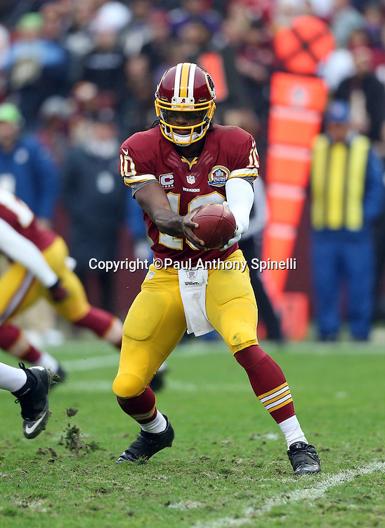 Washington Redskins quarterback Robert Griffin III (10) attempts a handoff to Washington Redskins running back Alfred Morris (46) in the read option formation during the NFL week 14 football game against the Baltimore Ravens on Sunday, Dec. 9, 2012 in Landover, Md. The Redskins won the game in overtime 31-28. ©Paul Anthony Spinelli
