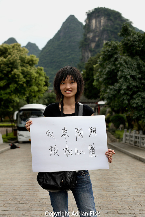 Zhang Lee Dan - 23 Yrs.<br /> Landscape gardener.<br /> Guangxi Province.<br /> <br /> 'I have come here to relax'.