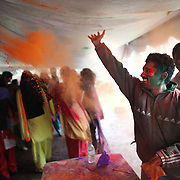 A participant throws powdered color during a Holi festival at the Sanatan Dharma Hindu Temple and Cultural Center in Maple Valley on Saturday, March 10, 2012. Holi, the Festival of Colors, is a Hindu festival welcoming spring. It is most well-known for the vibrant bursts of gulal, the powdered dye, that festivalgoers throw on each other. (Joshua Trujillo, seattlepi.com)