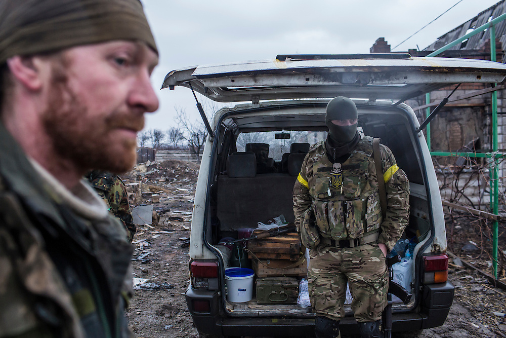 TALAKIVKA, UKRAINE - FEBRUARY 5, 2015: Members of the St. Mary's Battalion, a pro-Ukraine militia, near one of the group's front-line encampments in Talakivka, Ukraine. With more than 220 people having died in the past several weeks, a new diplomatic push is underway to bring an end to fighting between pro-Russia rebels and Ukrainian forces. CREDIT: Brendan Hoffman for The New York Times