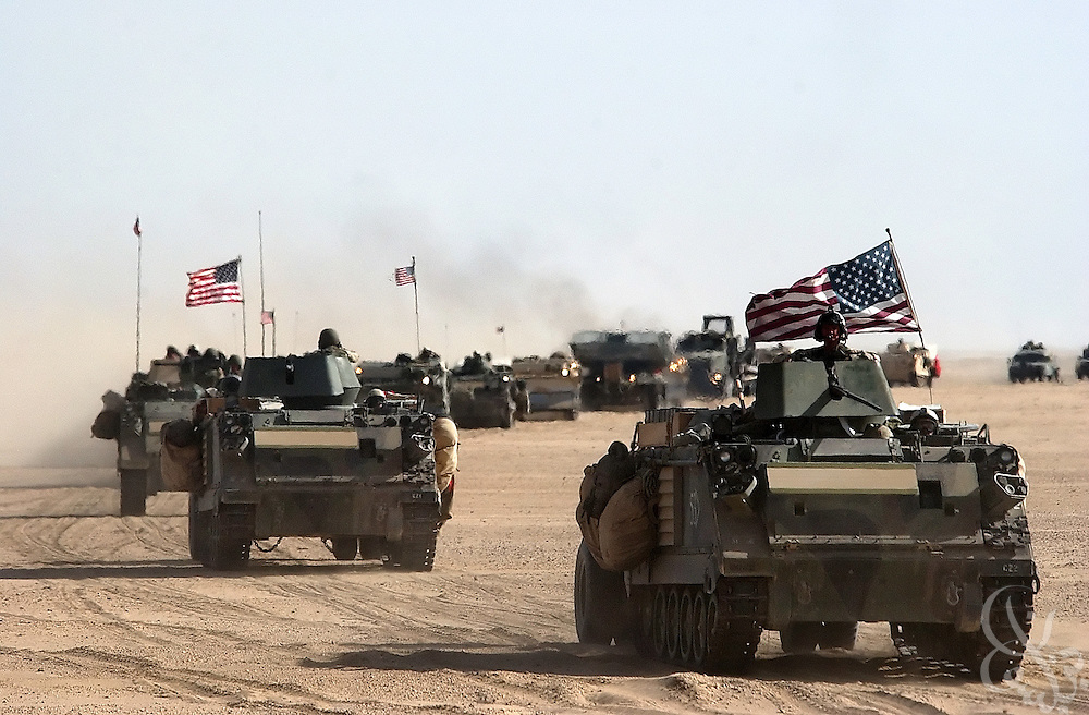 U.S. Army 11th Engineers attached to the 3-7 infantry move into position March 18, 2003 ahead of the invasion near the Kuwait-Iraq border.