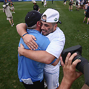 North Carolina Head Coach JOE BRESCHI, left, celebrates with  North Carolina Attackman CHRIS CLOUTIER (45), right,  after North Carolina defeated Maryland 14-13 in overtime during The NCAA Division I NATIONAL CHAMPIONSHIP GAME between North Carolina and Maryland, Monday, May. 30, 2016 at Lincoln Financial Field in Philadelphia, Pa