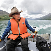 Ian Stewart/Yukon News<br /> Jimmy Johnny motors down Bonnet Plume Lake in the Yukon's Peel Watershed. Johnny has been hunting, guiding and wrangling horses in this area for more than 50 years.