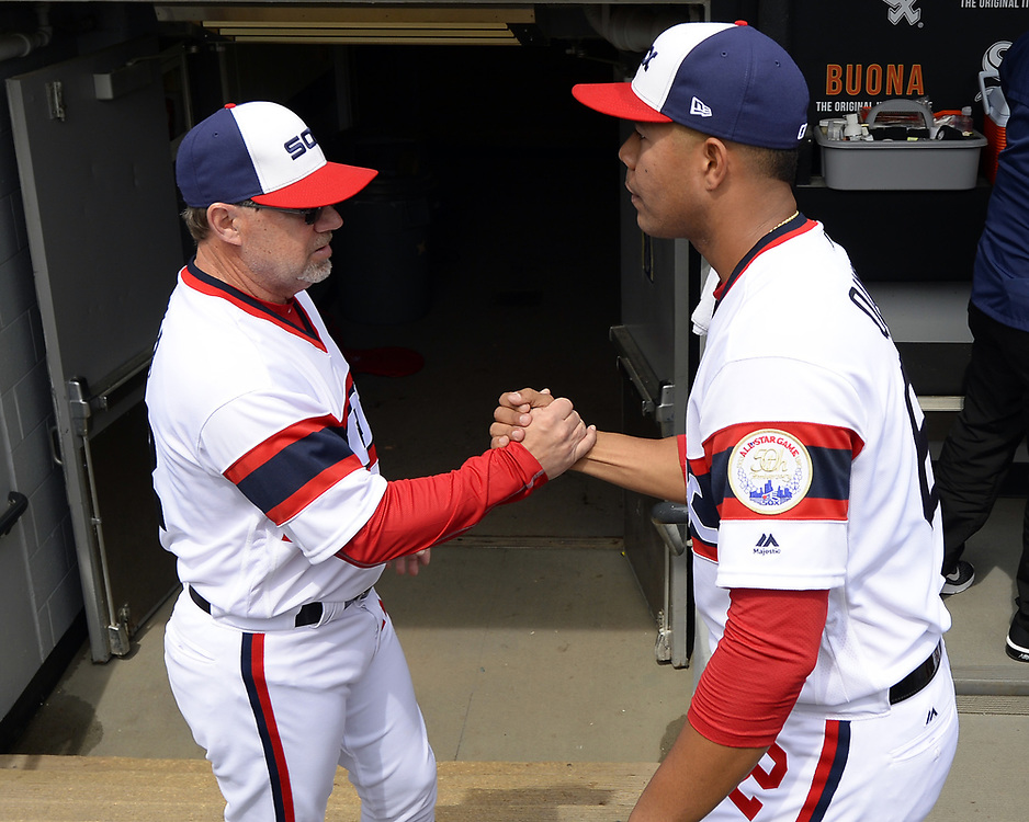 CHICAGO - APRIL 09:  Jose Quintana #62 shakes hands with third base coach Nick Capra #12 of the Chicago White Sox prior to the game against the Minnesota Twins on April 9, 2017 at Guaranteed Rate Field in Chicago, Illinois.  (Photo by Ron Vesely)   Subject:  Jose Quintana; Nick Capra