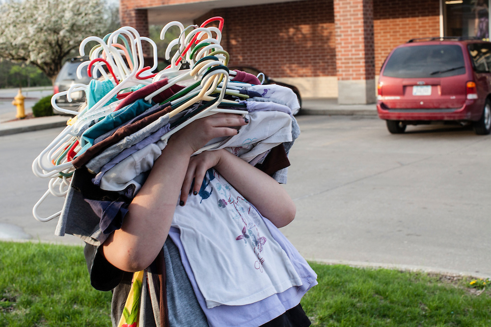 Libby Johnson holds her mother Penny's clothes on Friday, March 30, 2012 in Des Moines, IA.