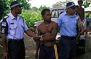 Sgt. Luke Qerewaqa (Fiji) & Sgt. Godfrey Abiah (RSIP) attend a dispute between neighbours at Burns Creek aka Dark Corner, an area notirous for crime and outbreaks of violence. Honiara, The Solomon Islands