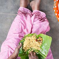 Eating tamarind rice on a banana leaf, Kariakudi, Tamil Nadu, India