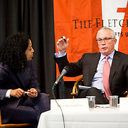 "10/26/2012 - Medford, Mass. -  GE Africa President and CEO Jay Ireland speaks during a panel titled, ""The Private Sector as a Catalyst for Development,"" at the Fletcher School's conference, ""Africa's Turn? The Promise and Reality of the Global Economy's 'Final Frontier,'"" at Tufts University on Oct. 26, 2012. Mimi Alemayehou, F98, executive vice president of the Overseas Private Investment Corporation, listens at left. (Kelvin Ma/Tufts University)"