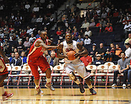 "Mississippi's Murphy Holloway (31) drives against Rutgers' Wally Judge (33) at the C.M. ""Tad"" Smith Coliseum in Oxford, Miss. on Saturday, December 1, 2012. (AP Photo/Oxford Eagle, Bruce Newman).."