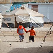 Amir, 5, and Adnan, 20 months, go for a walk. Zaatari Camp for Syrian Refugees, Jordan, November 2013.