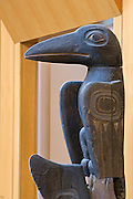 Raven figure on Tlingit totem pole in the Atrium of the Anchorage Museum of History and Art; Anchorage, Alaska.